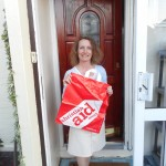 Carol Disspain of Lodge Brothers Molesey Collects for Christian Aid